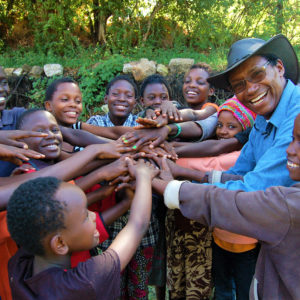 Charles Mulli with Mully Children in a circle