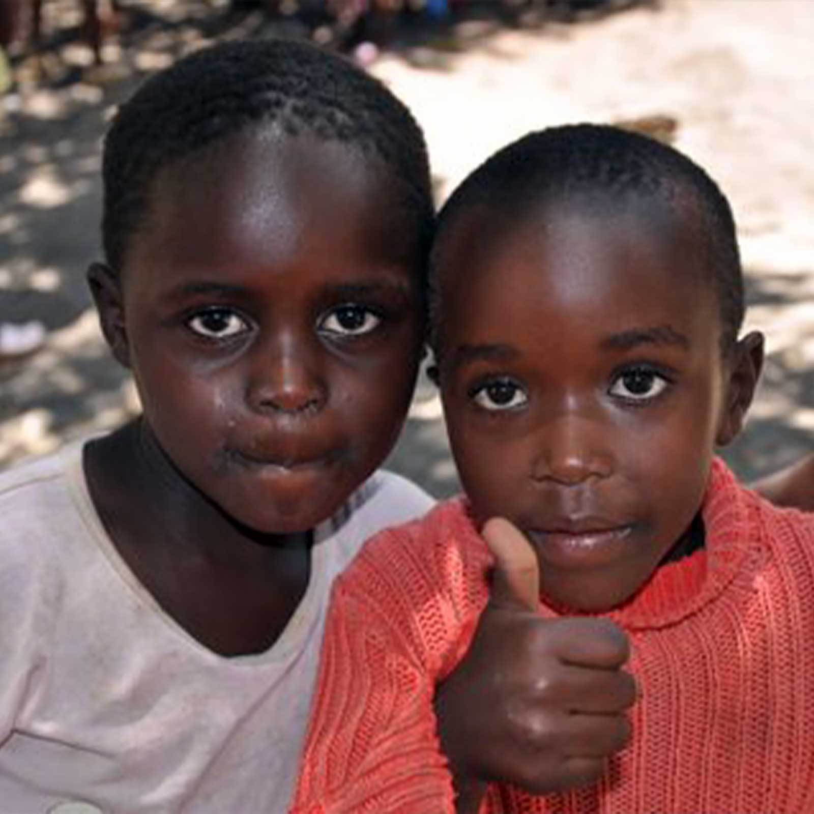photo: young children with thumbs up