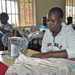 photo: young woman learning to sew