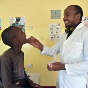 photo: Heathcare worker treating a child