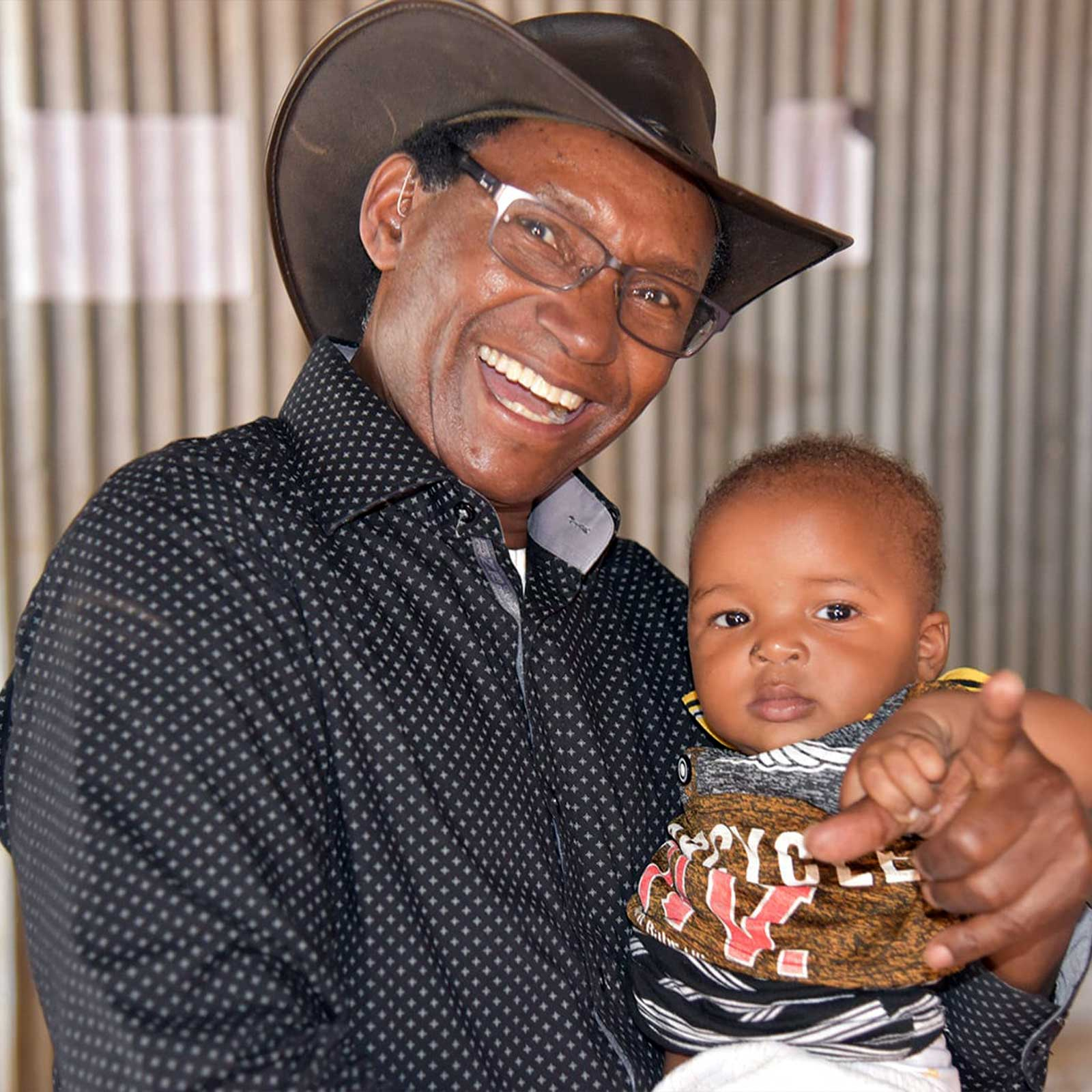 Charles Mulli with toddler